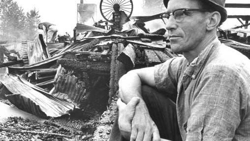 Dewey Johnson, an employee of the Capitol Lumber Company, looks over the damage after the July 8, 1968, fire. Capitol Lumber was the last lumber company in the city.