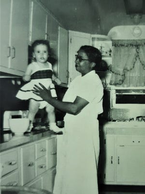 Saralee Perel, 2, and Ellen Sullivan, in the kitchen of the 15-room red brick house in Maryland.
