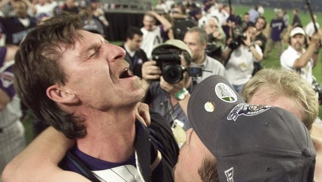 Randy Johnson celebrates after beating the Yankees in Game 7 of the World Series in Phoenix, AZ.