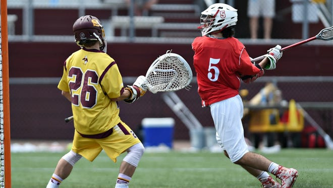 Denison's Will Donohue winds up to take a shot against Salisbury, Md. Sunday in the NCAA Division III national semifinals.