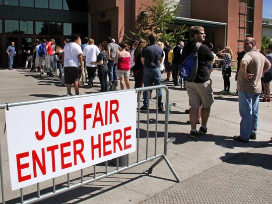 Hundreds of people came to the Oregon State Fairgrounds for a job fair to work at the upcoming State Fair, Tuesday, August 4, 2015, in Salem, Ore.