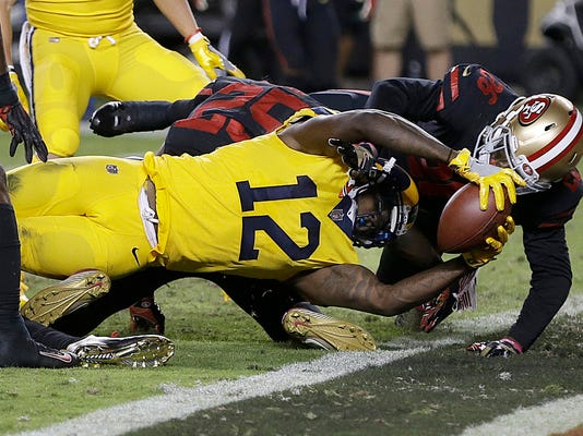 Los Angeles Rams wide receiver Sammy Watkins (12) scores a touchdown against the San Francisco 49ers during the second half of an NFL football game in Santa Clara, Calif., Thursday, Sept. 21, 2017. (AP Photo/Ben Margot)
