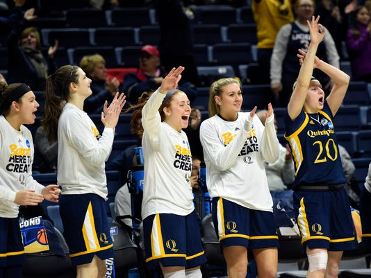 Quinnipiac players celebrates at the buzzer of a first-round game against Miami in the NCAA women's college basketball tournament in Storrs, Conn. Saturday, March 17, 2018. Quinnipiac won, 86-72. (AP Photo/Stephen Dunn)