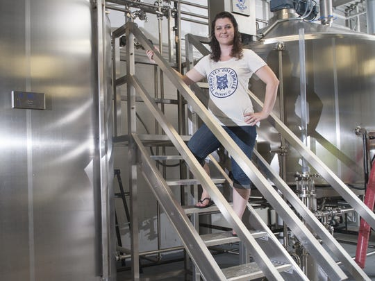 Jamie Queli, owner of Forgotten Boardwalk Brewing CO. in Cherry Hill, stands in her company's brewery IN 2014.
