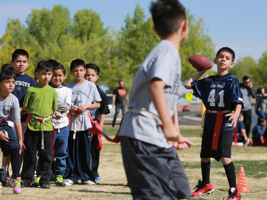 El Paso Cowboys player Isaiah Acosta throws a pass during a flag football practice.
