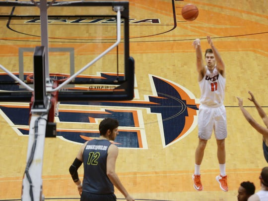 UTEP's Jake Flaggert fires a long-range jumper Thursday.