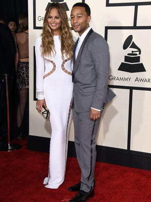 Chrissy Teigen, left, and John Legend arrive at the 57th annual Grammy Awards at the Staples Center on Sunday, Feb. 8, 2015, in Los Angeles.