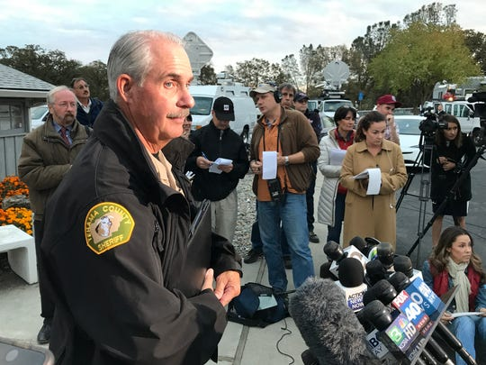 Tehama County Assistant Sheriff Phil Johnston answers reporters' questions Tuesday outside the Rancho Tehama rec hall.