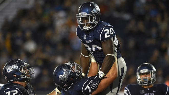 Nevada's James Butler celebrates a touchdown with his teammates during the Wolf Pack's win over Buffalo on Saturday.