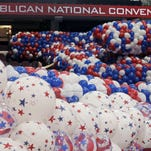 Dave Strnisa, left, moves a bag of balloons as preparations continue for the Republican National Convention, Fridayin Quicken Loans Arena in Cleveland.
