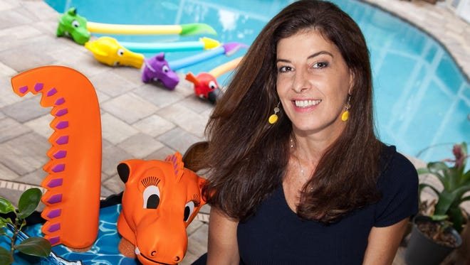 Artist Andrea McCoy at home surrounded by her creation, Noodle Petz.
