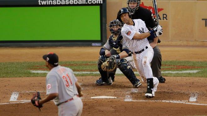 American League shortstop Derek Jeter, of the New York Yankees, singles during the third inning of the MLB All-Star baseball game