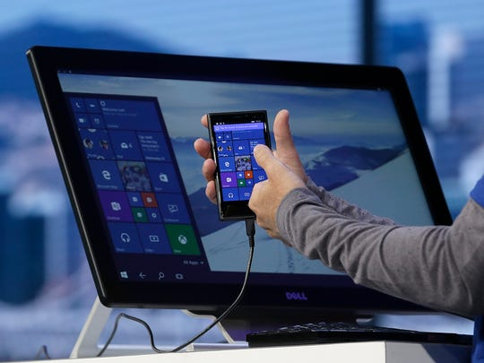 Joe Belfiore, Microsoft's vice president of operating systems, demonstrates the new Windows 10 operating system at the Microsoft Build conference Wednesday in San Francisco.