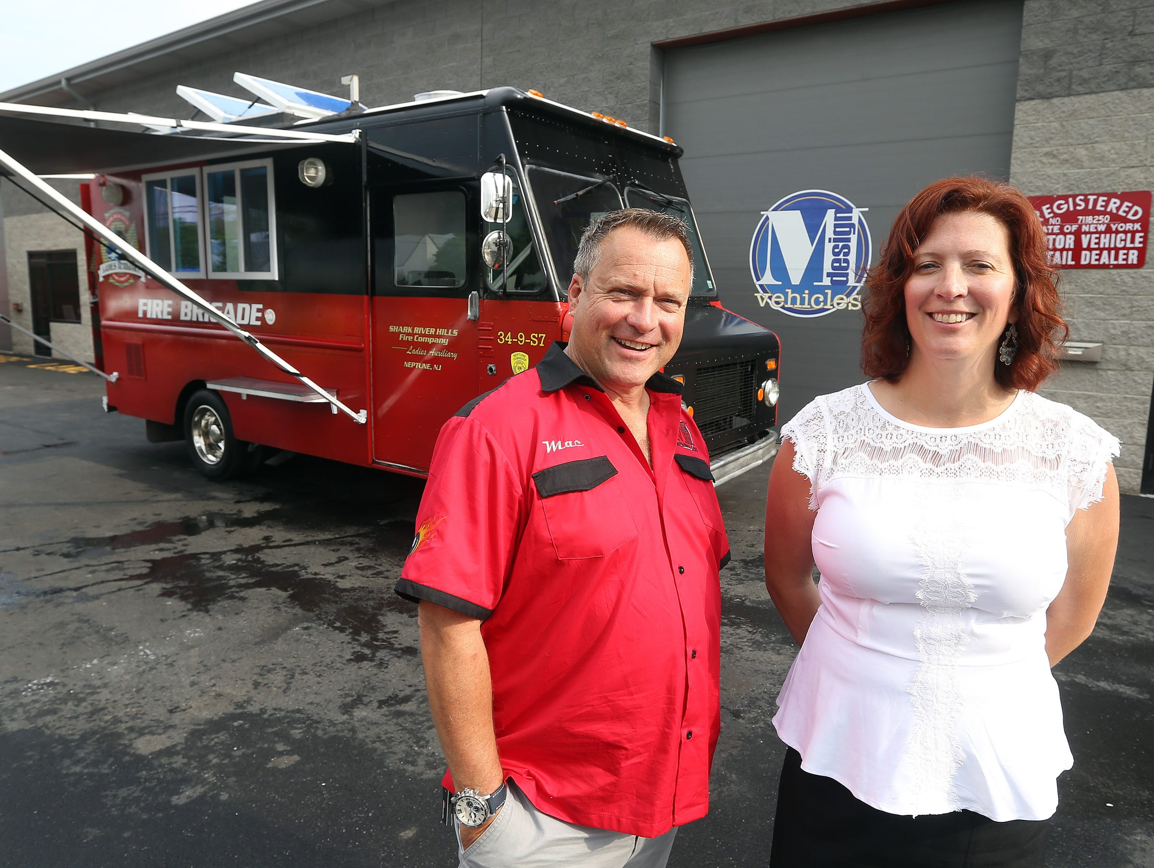 2014 file photo: Ian Macdonald and Maggie Tobin, of M Design Vehicles, with a renovated truck to be delivered to a fire company in New Jersey.