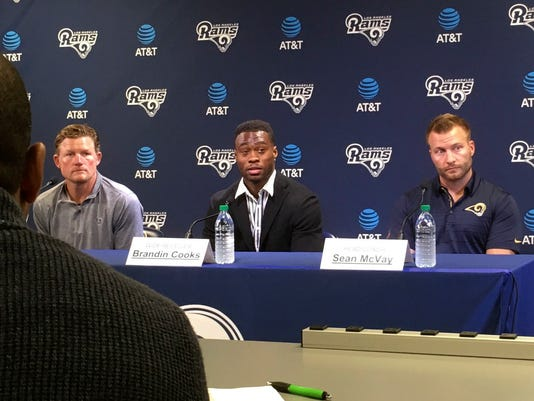 Los Angeles Rams' Brandin Cooks, center is joined during a news conference by head coach Sean McVay, right, and general manager Les Snead, left, at the team's practice facility, in Thousand Oaks, Calif., Thursday, April 5, 2018. Cooks was one of the NFL's best receivers the last three seasons. (AP Photo/Greg Beacham)