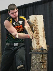 William Adams of Owego N.Y., swings away in a lumberjacking