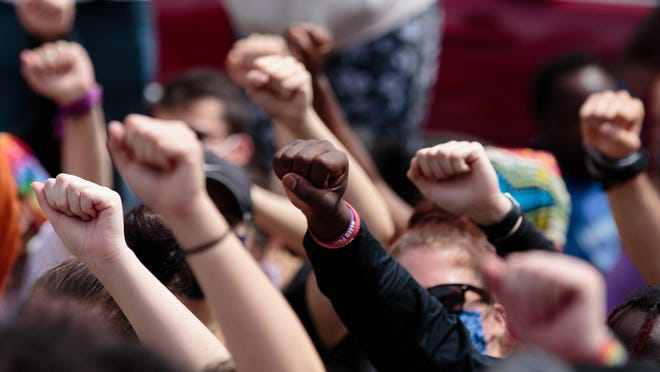 In this June 1, 2020 file photo, protestors raise their fists while gathered at Columbus City Hall following the death of Minneapolis resident George Floyd while in police custody. A jury on Tuesday convicted Minneapolis police officer Derek Chauvin of second- and third-degree murder and second-degree manslaughter in Floyd's death.