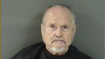Darrell Hinkkanen, 74, was charged with aggravated battery with a deadly weapon after deputies say he threatened a landscaper.