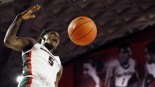 Georgia's Anthony Edwards (5) celebrates after dunking the ball during an NCAA basketball game between North Carolina Central and Georgia in Athens, Ga., on Wednesday, Dec. 4, 2019.