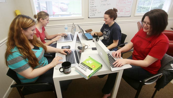From left, Lisa French, Rachel Werner,  Ann Touchstone and Eliza Brock work on their computers during the Nashville Women Programmers meet-up group on Aug. 3, 2013.
