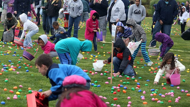 Children scramble for Easter eggs.