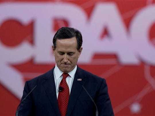 Former Pennsylvania Sen. Rick Santorum pauses as he speaks during the Conservative Political Action Conference (CPAC) in National Harbor, Md., Friday, Feb. 27, 2015. (AP Photo/Carolyn Kaster)