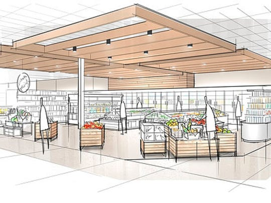 """This image provided by Target Corp. shows a rendering of an area of a redesigned Target store, featuring an """"ease"""" entrance to the grocery section."""