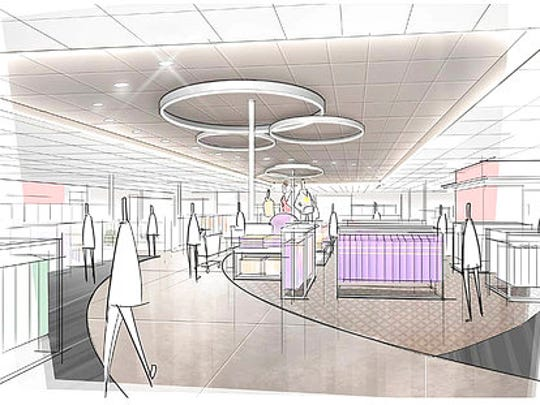 This image provided by Target Corp. shows a rendering of an area of a redesigned Target store featuring a curved center aisle, meant to inspire people to explore the merchandise.