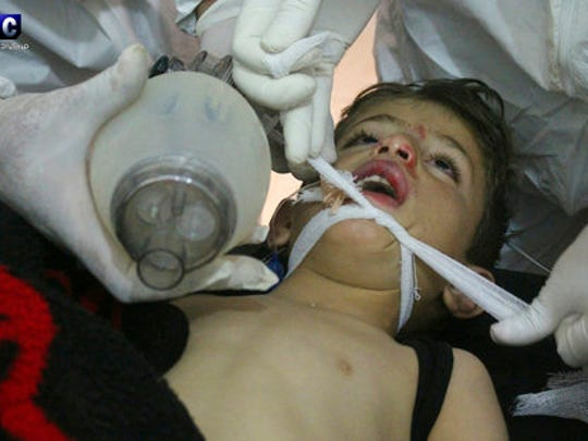 FILE -- In this Tuesday, April 4, 2017 file photo, provided by the Syrian anti-government activist group Edlib Media Center, which has been authenticated based on its contents and other AP reporting, shows Syrian doctors treating a child following a suspected chemical attack, at a makeshift hospital, in the town of Khan Sheikhoun, northern Idlib province, Syria. Turkey's health minister, Recep Akdag, said Tuesday, April 11, 2017, that test results conducted on victims of the chemical attack in Khan Sheikhoun confirm that sarin gas was used.