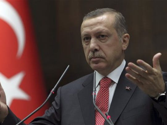 Turkish President Recep Tayyip Erdogan addresses the lawmakers of his  Justice and Development Party at the parliament in Ankara, Turkey, Tuesday, June 26, 2012. At the time, he was prime minister.