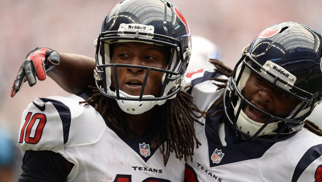 Houston Texans wide receiver DeAndre Hopkins (left) and wide receiver Keshawn Martin (right) celebrate the winning touchdown against the Tennessee Titans during overtime at Reliant Stadium. The Texans won 30-24 on Sept. 15.
