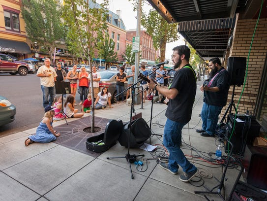 Musicians perform during 2016's Make Music Day in downtown Salem
