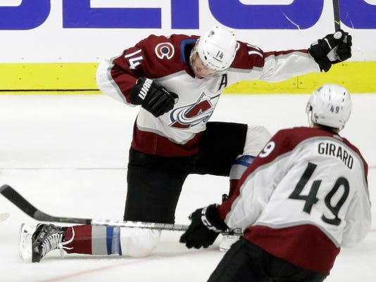 Colorado Avalanche left wing Blake Comeau (14) celebrates after scoring a goal against the Nashville Predators during the second period in Game 1 of an NHL hockey first-round playoff series Thursday, April 12, 2018, in Nashville, Tenn. In the foreground iis Samuel Girard (49). (AP Photo/Mark Humphrey)