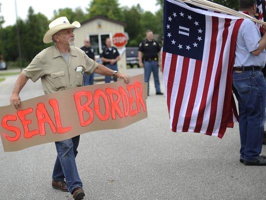 2014 398825127-Immigration_Overload_Michigan_MIDTN101_WEB144301.jpg_20140715.jpg