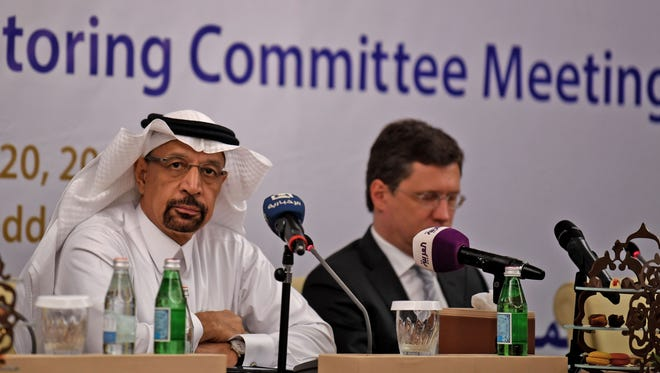 Saudi Energy Minister Khaled al-Faleh, left, and Russian Energy Minister Alexander Novak attend a meeting of OPEC and non-OPEC members to assess compliance with production cuts and to discuss potential long-term cooperation, in Jeddah on April 20, 2018.