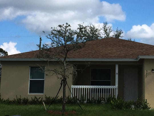 The Blue house built by St. Lucie Habitat for Humanity, with the help of Dyer Chevrolet Fort PIerce.