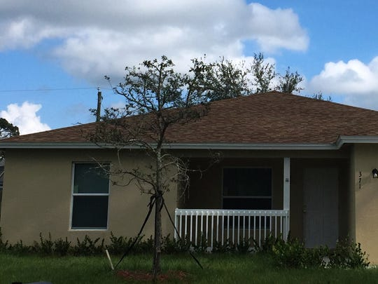 A photo of the Blue house built by St. Lucie Habitat