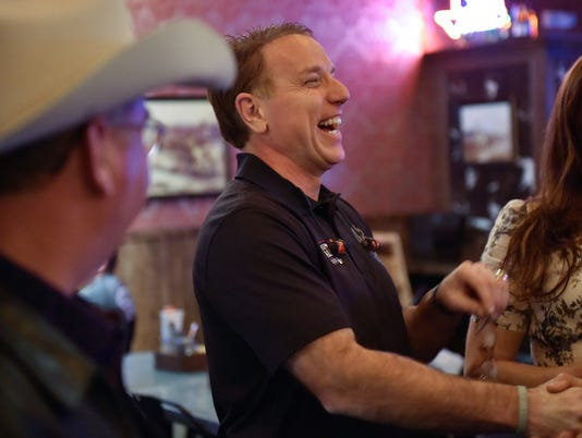 Collin County businessman Pat Fallon, 50, is congratulated by locals during a watch party at Tex Tapas.