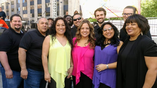 "A recent photo of 11 of the 12 members of Orquesta Kandela, a Cincinnati-based salsa band that will perform June 14 as part of the Clifton Cultural Arts Center's free ""Wednesdays on the Green"" series."