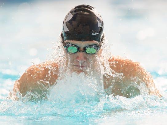 Sebastian River's Alec Mesh swims the breaststroke