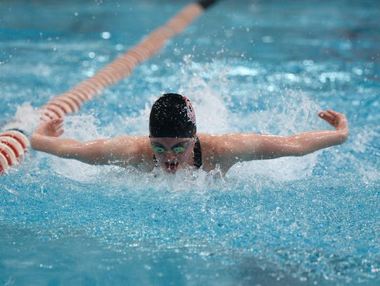 Elgin's Madison Linstedt competes in the 100-yard butterfly during the state swimming meet in Canton.