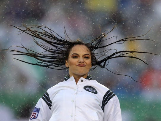 A member of the New York Jets flight crew performs