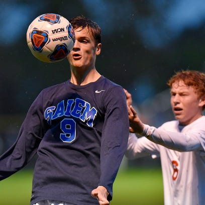 Salem's Christian Freitag (No. 9) watches the ball