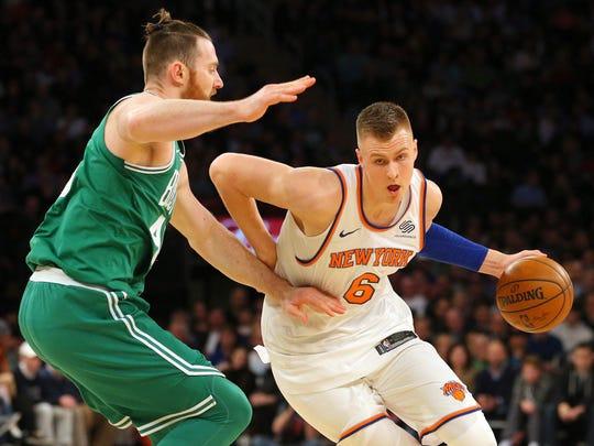 New York Knicks power forward Kristaps Porzingis (6) drives against Boston Celtics center Aron Baynes (46) during the second quarter at Madison Square Garden on Thursday, Dec. 21, 2017.