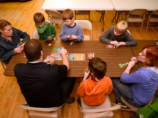 Members of Cascade County Homeschoolers play board games on Wednesday afternoon at Know Dice.