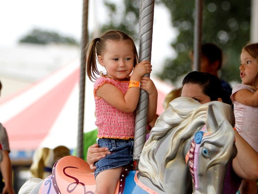 Free ride day at the 78th Ozark Empire Fair attracted thousands on Wednesday, July 30, 2014.