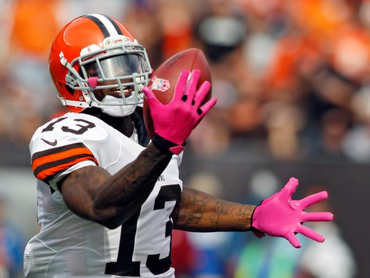 FILE - In this Oct. 14, 2012, file photo, Cleveland Browns wide receiver Josh Gordon makes a one-handed catch on a 71-yard touchdown reception in the second quarter of an NFL football game against the Cincinnati Bengals in Cleveland. Gordon is stepping on the field for the first time in 2014 following a lengthy suspension. (AP Photo/Scott R. Galvin, File)