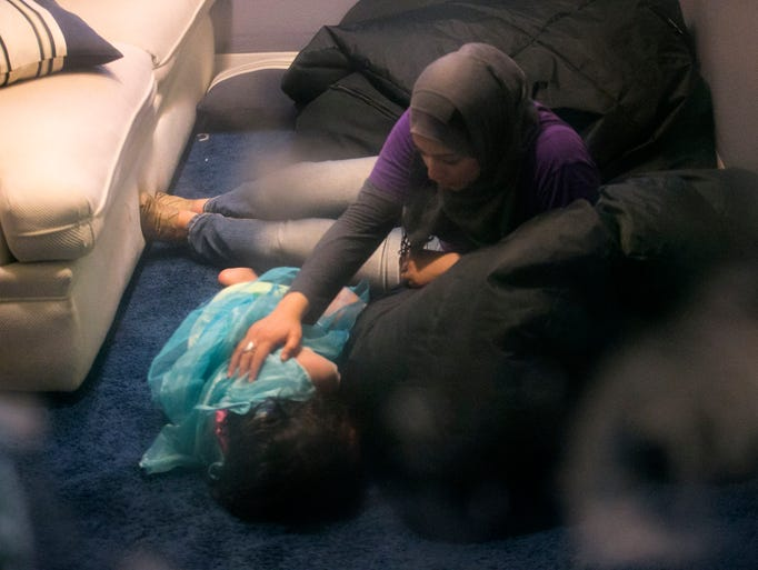 Child development specialist Amany Al-Sayyed, comforts
