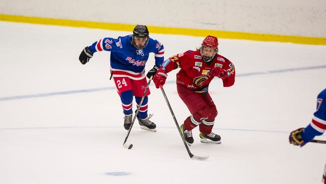 Feroze Schenck moves up ice with a player from the Frolunda Hockey Club.