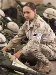 Pfc. Lori Piestewa preparing to board the bus to a waiting plane Feb. 18, 2003 at the rapid deployment facility at Fort Bliss, Texas.